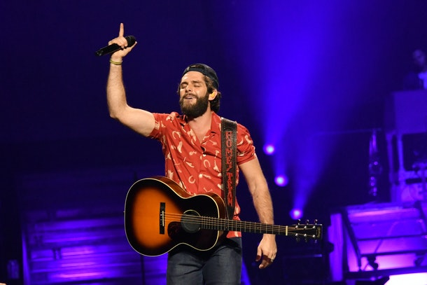 Thomas rhett performing with guitar