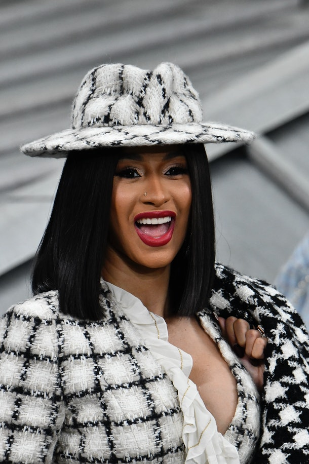 Cardi B slays in a black and white patterned ensemble.