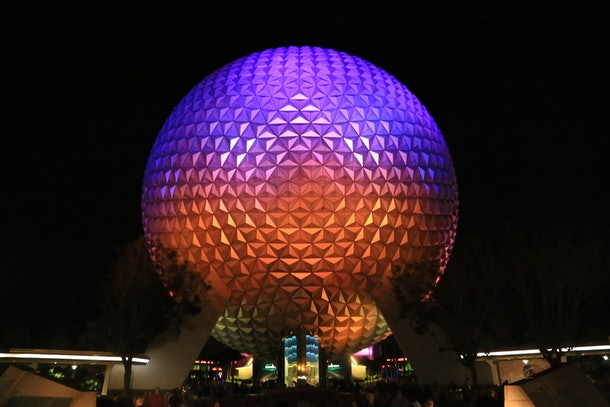 Disney's Epcot park is illuminated with different colors at night, and around the holidays.