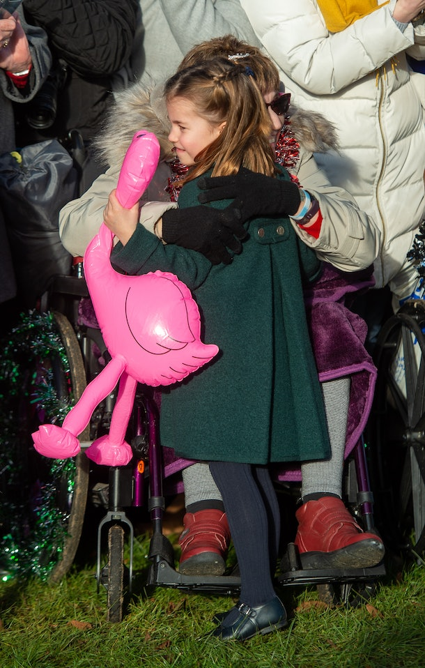 Princess Charlotte held a pink ostrich balloon during her walk.