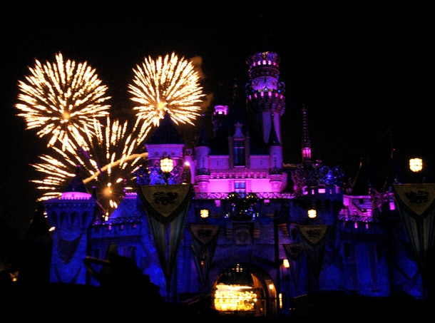 Fireworks fly into the sky behind Disneyland's Sleeping Beauty Castle.