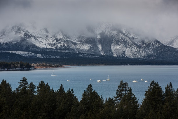The snowy mountains looking over South Lake Tahoe are covered with a layer of fog.