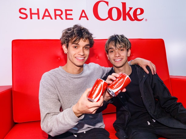 The Dobre Twins attend an event for Coca Cola.