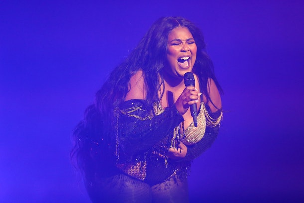 Lizzo belts out a tune live in concert.