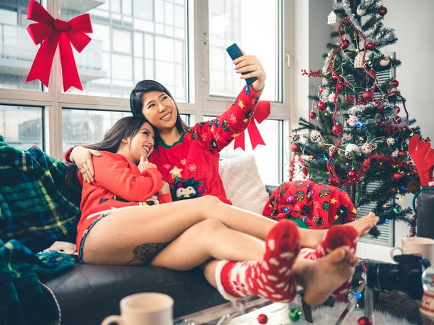 Two happy girls pose for a selfie in their holiday loungewear on Christmas morning.