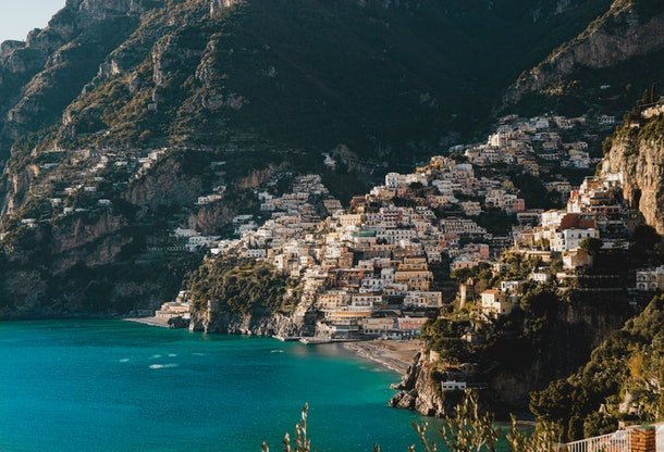 Positano, Italy and its colorful architecture are tucked into the Italian coastline.