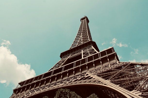 The Eiffel Tower in Paris stands tall on a sunny day.
