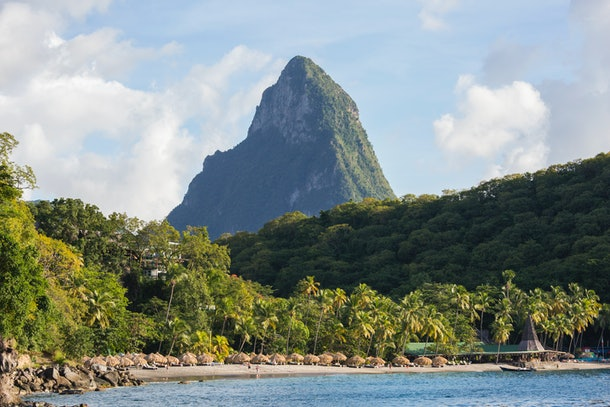 The lush mountains of Saint Lucia tower over the cozy beaches on a sunny afternoon.