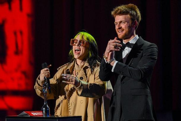 Billie Eilish and Finneas accept an award.
