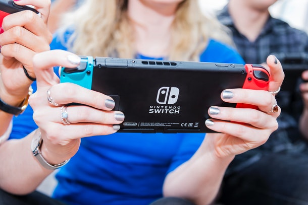 A young woman plays 'Animal Crossing' on her Nintendo Switch.