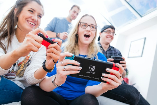 A group of friends plays on their Nintendo Switches.
