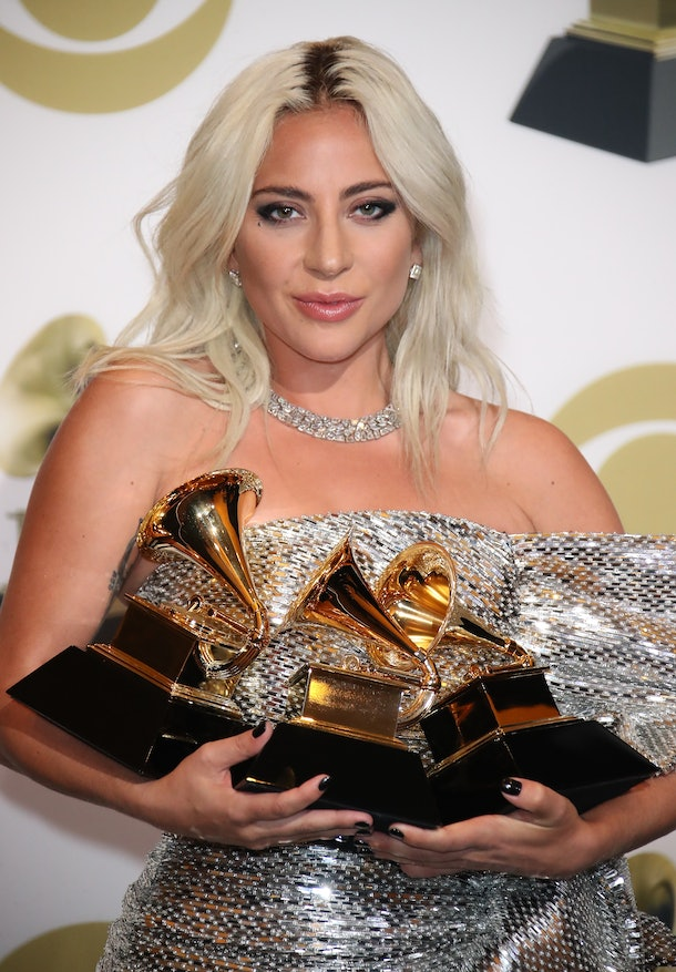 Lady Gaga poses with her Grammy Awards.
