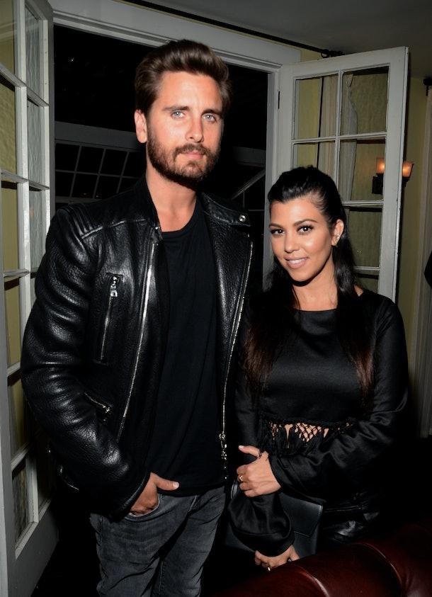 Scott Disick and Kourtney Kardashian pose for a photo together.