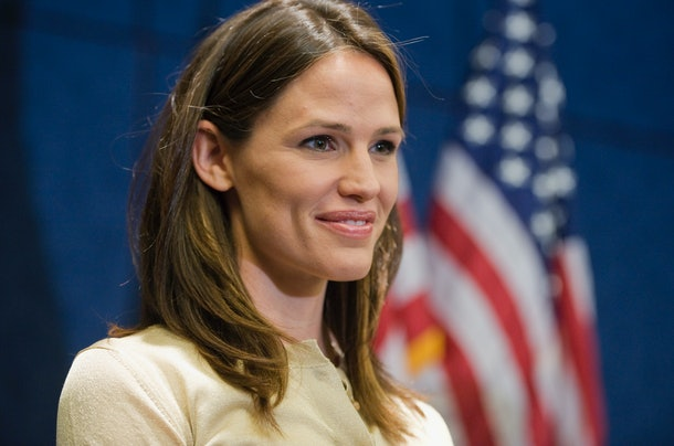 Jennifer Garner is photographed in front of the American flag.