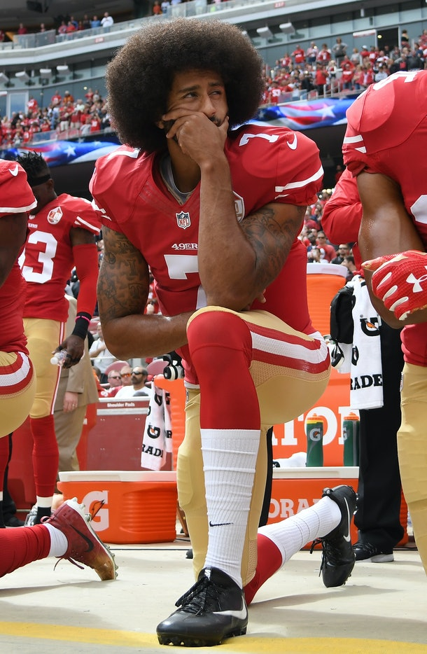 Colin Kaepernick kneels during an NFL game.