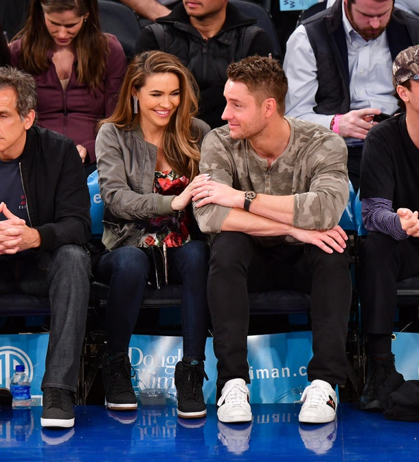 Chrishell Stause and Justin Hartley attend a basketball game.