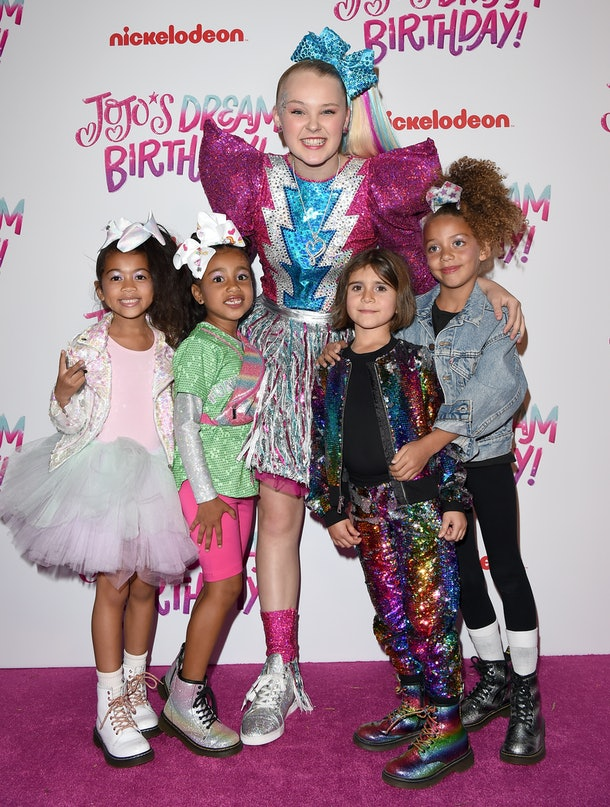 North West, Penelope Disick, and friends attend JoJo Siwa's birthday party.