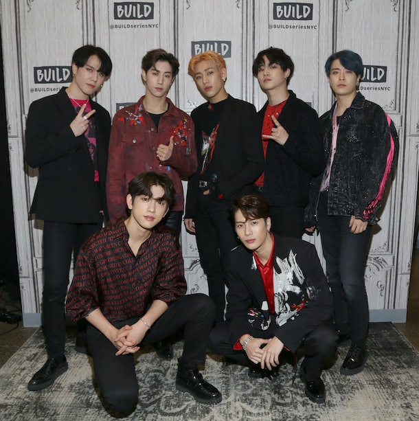 GOT7 pose for a group picture outside the 'BUILD Series.'