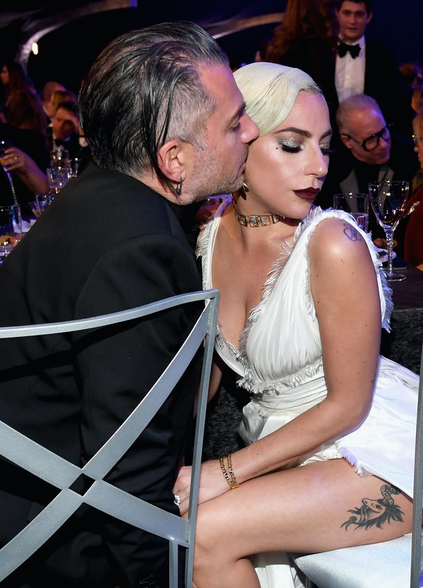 Christian Carino kisses Lady Gaga on the cheek.