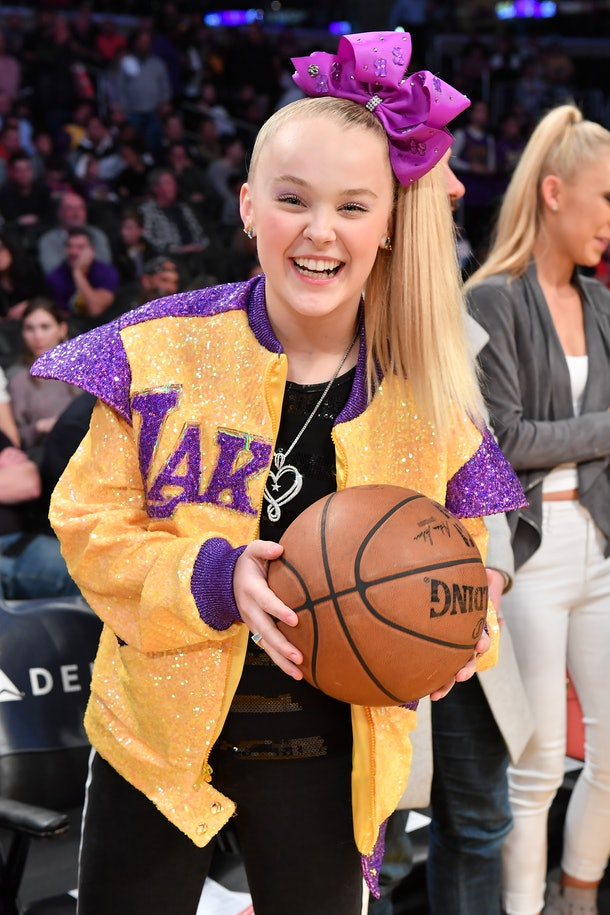 JoJo Siwa attends a Lakers game.