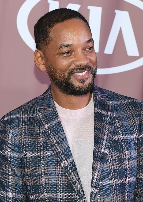 Will Smith smiles on the red carpet.