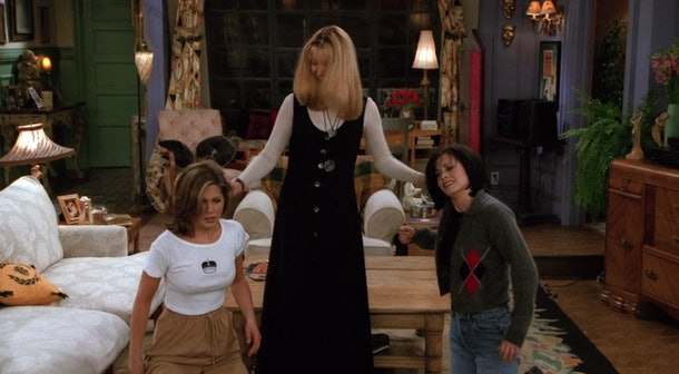 Phoebe holds Rachel's and Monica's ears in their living room in 'Friends.'