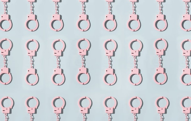 Colorful graphic of handcuffs.