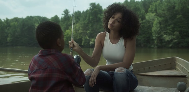 Alisha Wainwright with co-star Ja'Siah Young in a boat