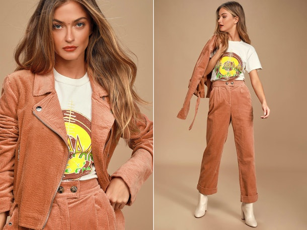 A woman wears a corduroy pant set that's a great comfy plane outfit for fall.