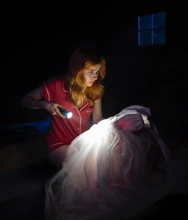 Nancy Drew discovering Lucy Sable's bloody dress in her attic