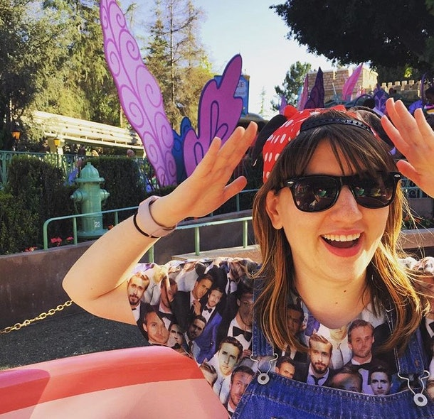 A woman wearing a Minnie Mouse hat while sitting in the teacups at Disneyland.