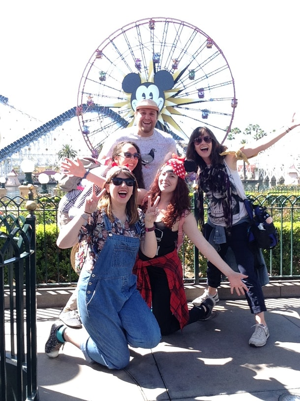 Friends pose in front of the pier at Disney's California Adventure Park.