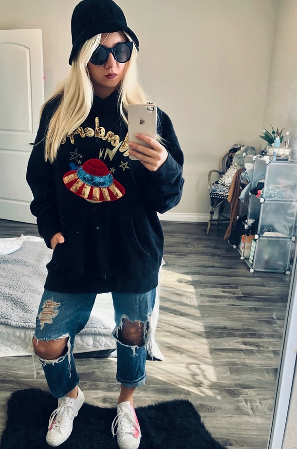 On day 6,  I channeled Eilish by rocking ripped denim, sneakers, and an over-sized hoodie.