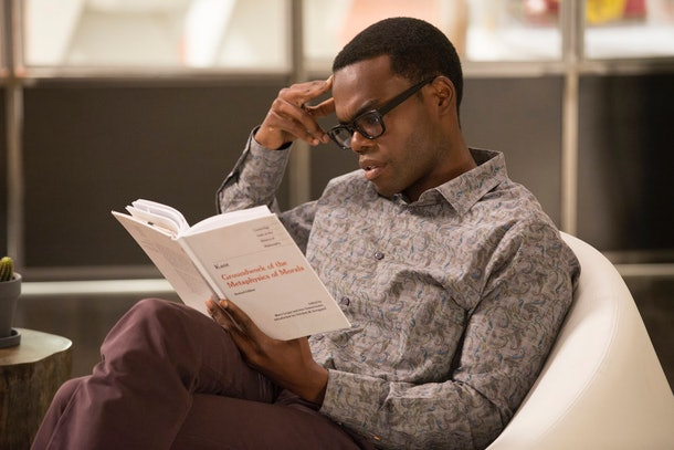 Chidi reads a book which clues us in on this The Good Place theory for a final seaso