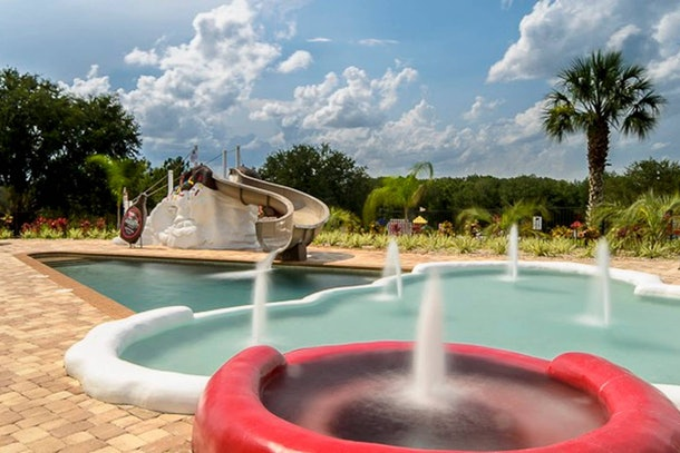 View of ice cream swimming pool with sundae water slide at Sweet Escape Airbnb.