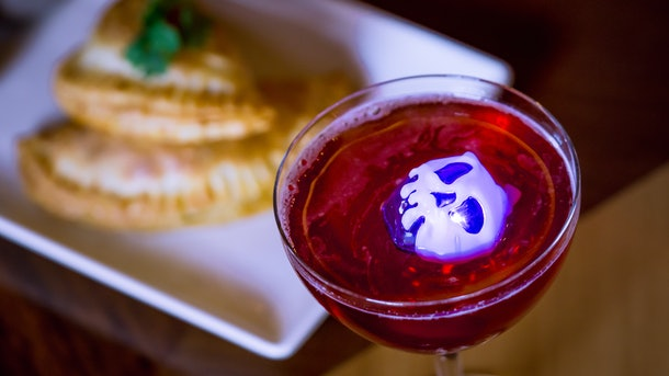 This Poison Apple-Tini is an Instagrammable Disney drink that's available at Disneyland for Halloween time.