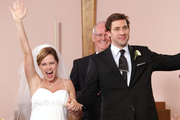 Pam (Jenna Fischer) and Jim (John Krasinkski) celebrate their wedding on The Office