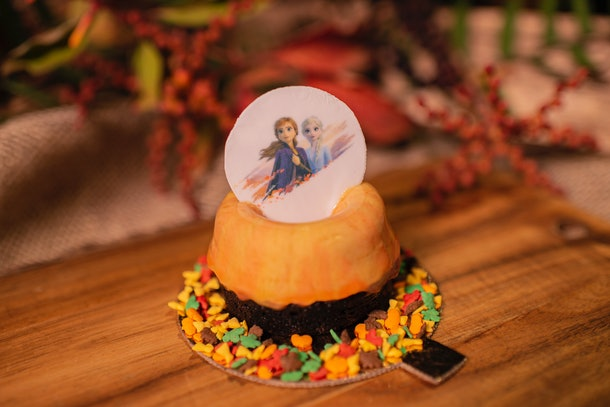 The Fall Into Winter Dessert cake — which is orange and has leaf-shaped sprinkles on the bottom — is available at Disney in celebration of the 'Frozen 2' release.
