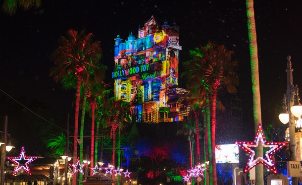 The Tower of Terror at Disney World lights up in multi-colored lights for the holiday season.