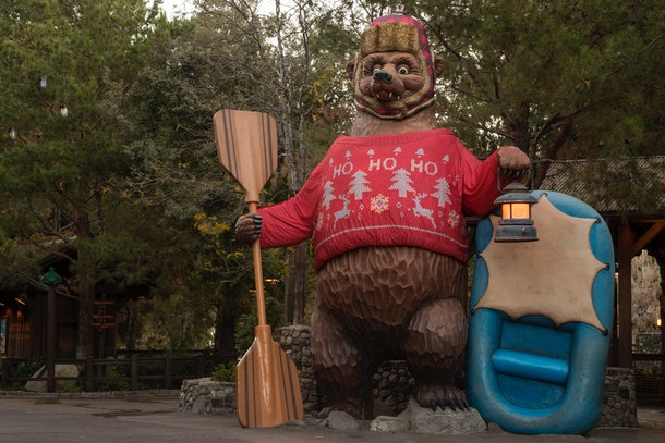 The Grizzly Peak Bear at Disney's California Adventure gets a holiday makeover with a Christmas sweater.