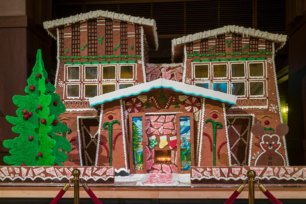 The giant gingerbread house sits in the Disney's Grand Californian Hotel lobby during the holidays.