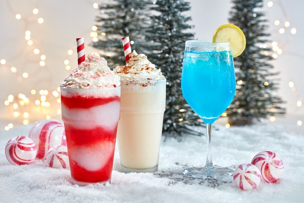 Frozen festive drinks sit on fake snow, and are available at Universal Orlando Resort's Holiday Celebration.