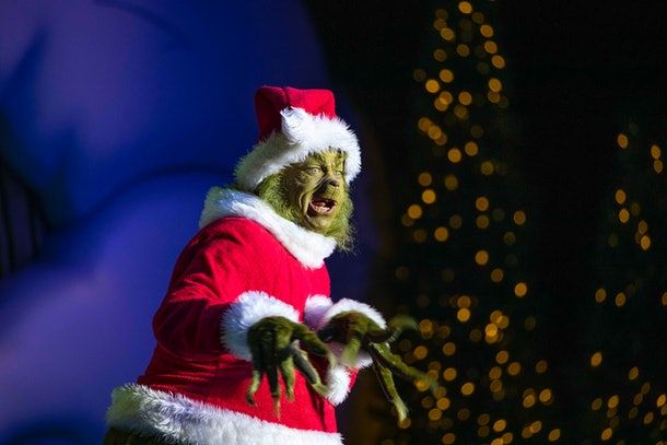 The Grinch stands in Seuss Landing during Universal Orlando Resort's Holiday Celebration.