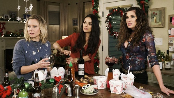 Three moms open wine bottles and eat Chinese food in the kitchen in A Bad Moms Christmas.