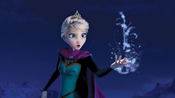 Elsa from Disney's Frozen holds a magical snowflake in her hand.