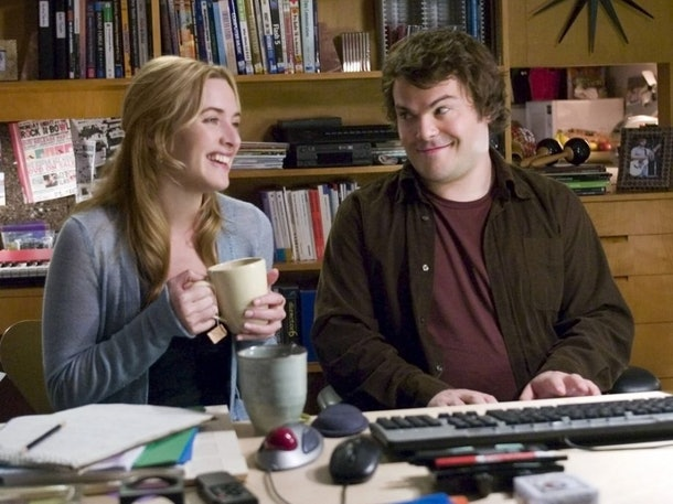 Kate Winlset and Jack Black laugh during a scene from The Holiday.
