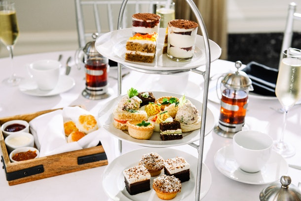 The spread at Waldorf Astoria Atlanta Buckhead's afternoon tea includes sweet pastries, breads, and tea.