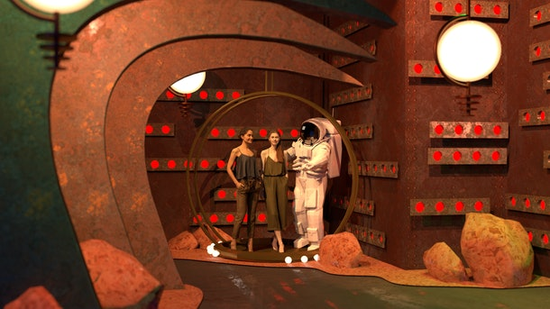 """The """"Oops!... I Did It Again"""" room on Mars from the Britney Spears pop-up features an astronaut and two girls."""