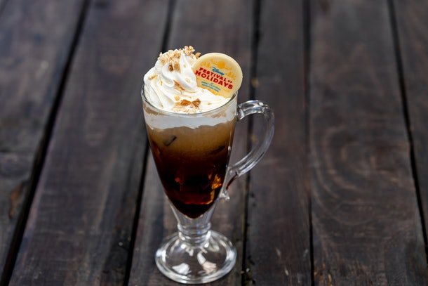 The churro toffee cold brew drink with whipped cream is offered at Disneyland's holiday celebration.