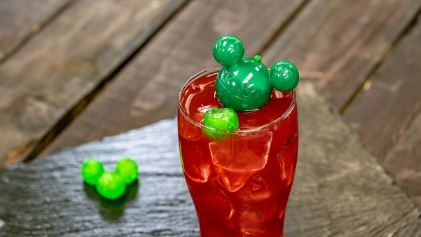 The red Navidad Punch with a green Mickey-shaped ice cube is offered at Disneyland's holiday celebration.